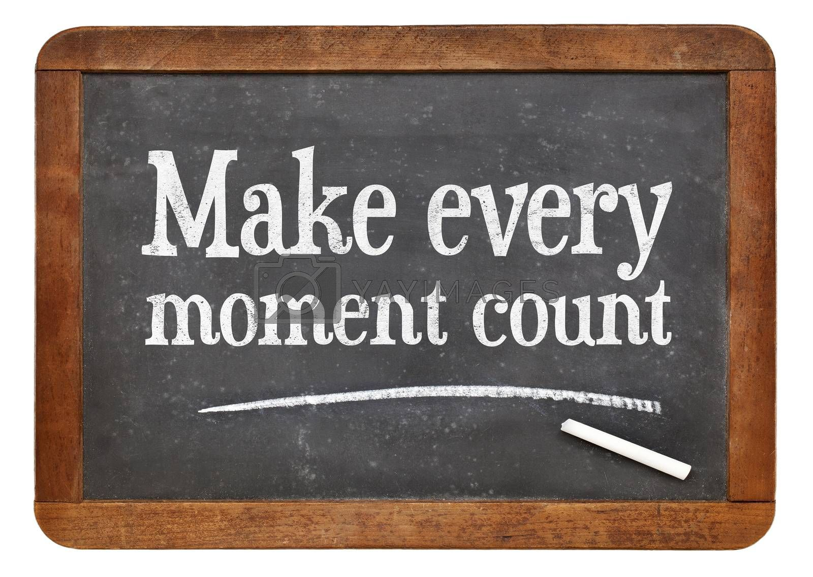 Make every moment count - white chalk text on a vintage slate blackboard