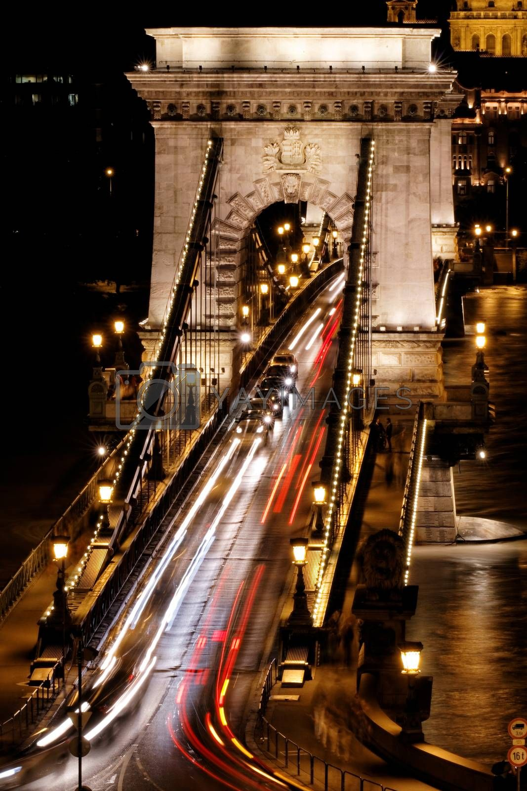 Public transport on the Suspension Bridge at night in Budapest