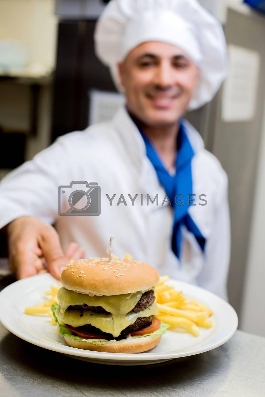 Fresh bagel hamburger serve with finger chips
