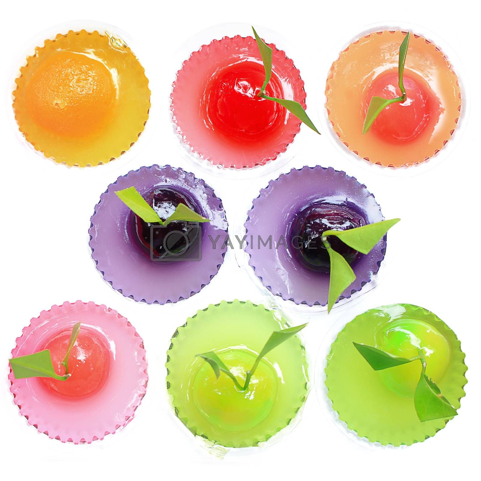 Different colored jelly sweets with white background