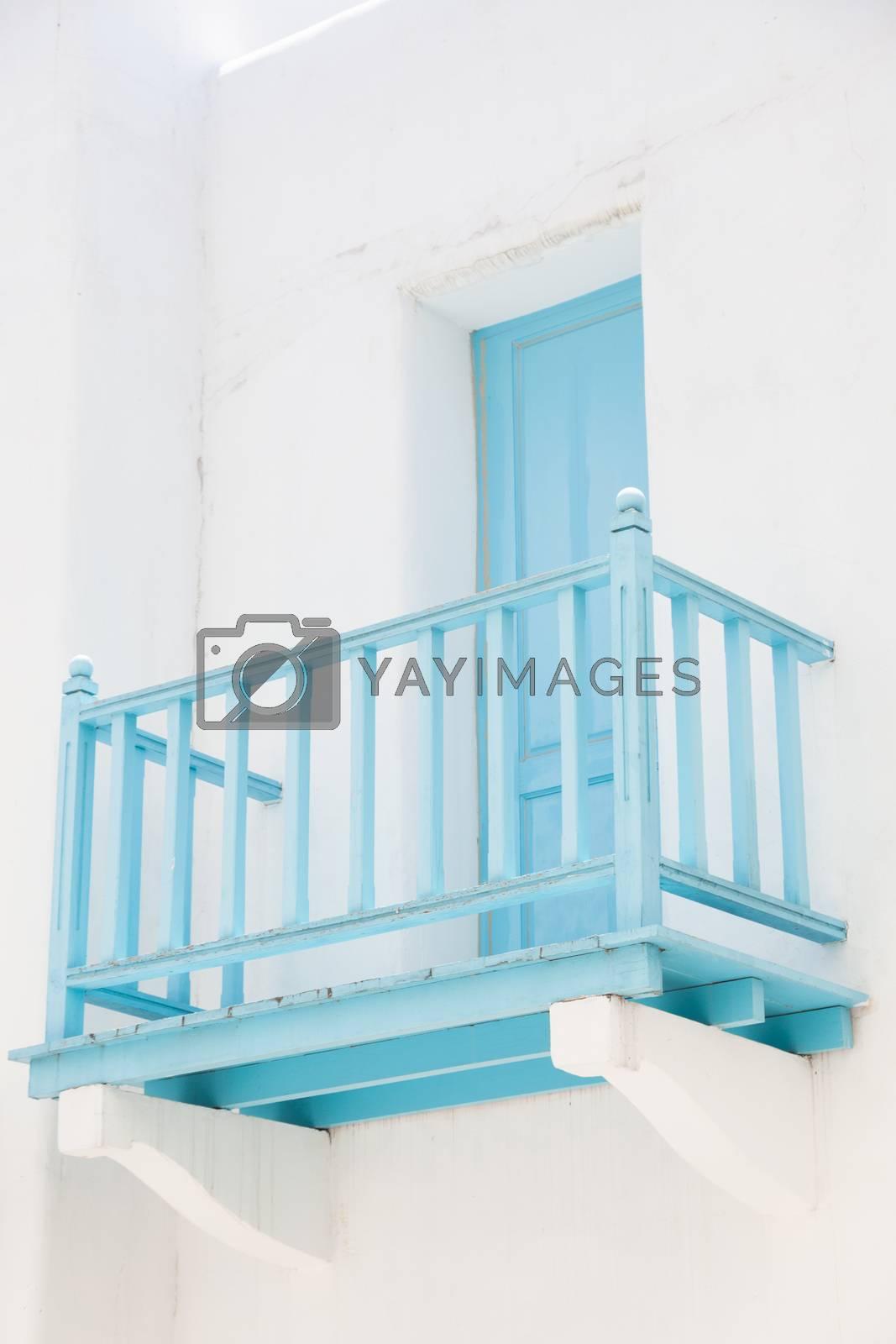 Balcony door walk out terrace of Hotel Blue. Blue wooden balcony