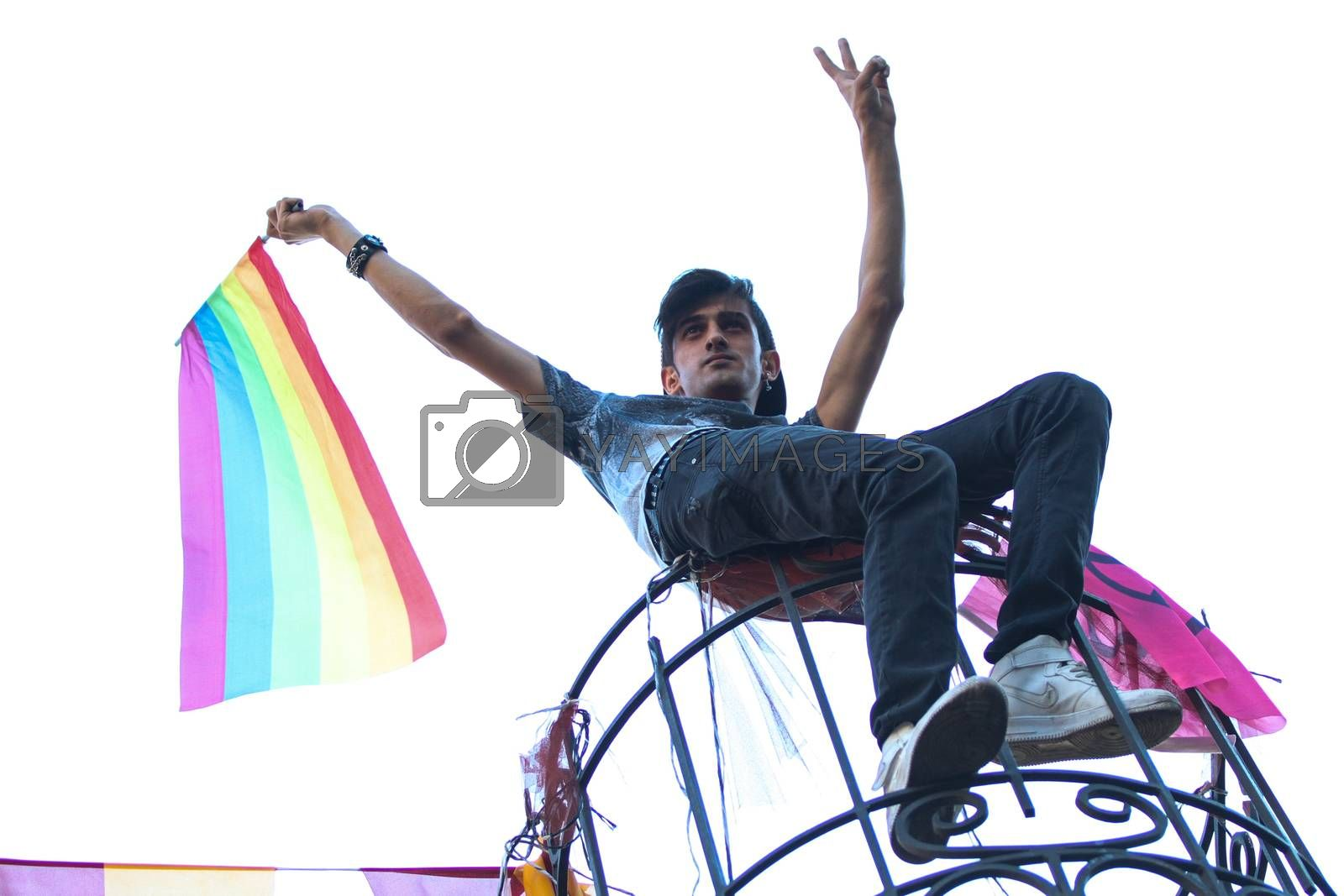 ISTANBUL, TURKEY - JUNE 21, 2015: Man with LGBT flag during Istanbul Trans Pride March in Istiklal Avenue at the beginning of Istanbul LGBT Pride Week.