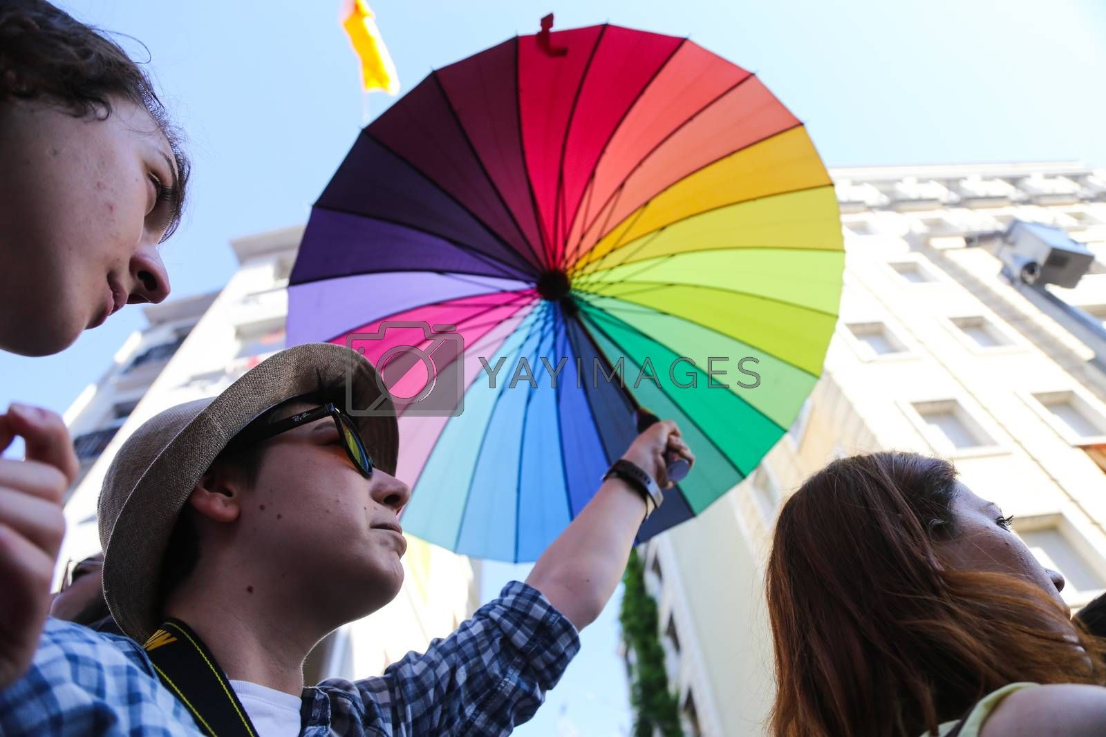 ISTANBUL, TURKEY - JUNE 21, 2015: Man with LGBT umbrella during Istanbul Trans Pride March in Istiklal Avenue at the beginning of Istanbul LGBT Pride Week.