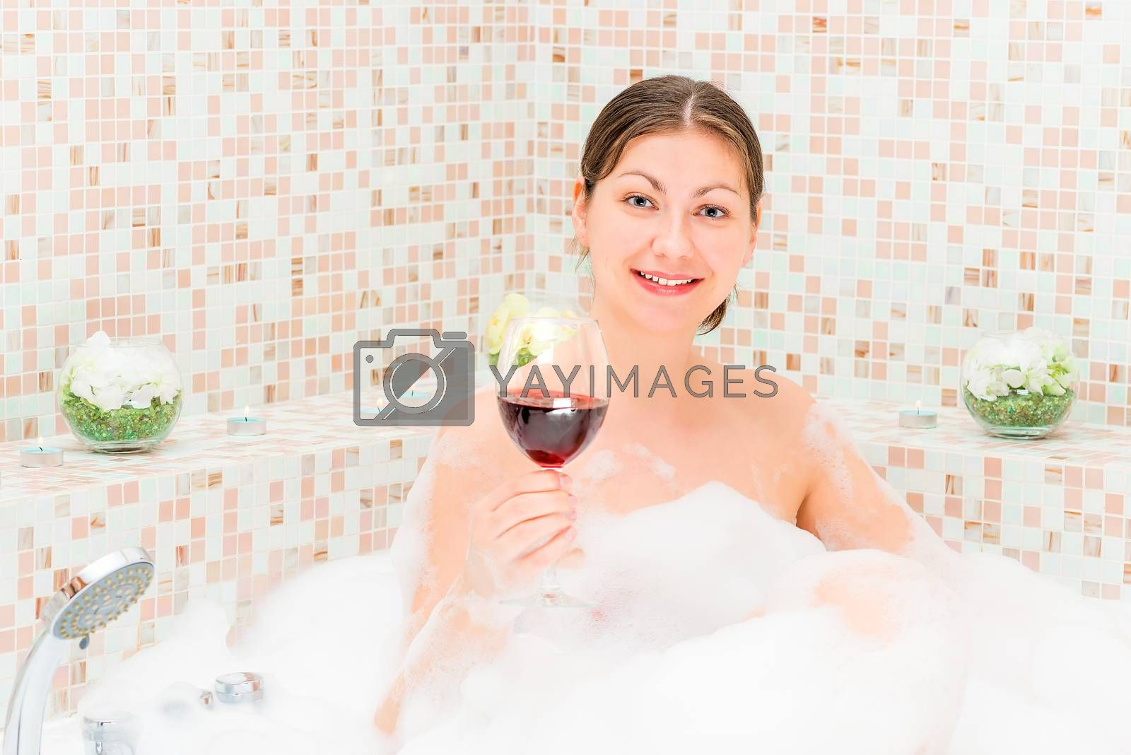 romantic girl with a glass of wine in the jacuzzi with foam by kosmsos111