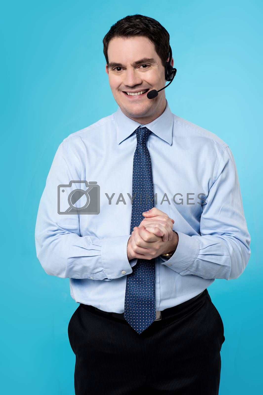 Customer support executive male with clasped hands