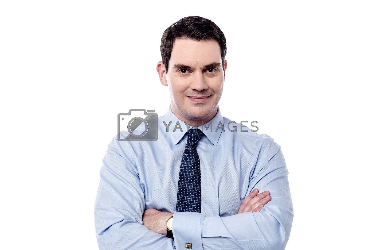 Handsome male executive posing with confidence over white