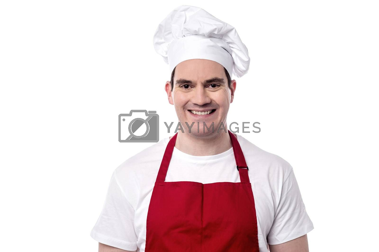 Smiling male chef posing to camera over white