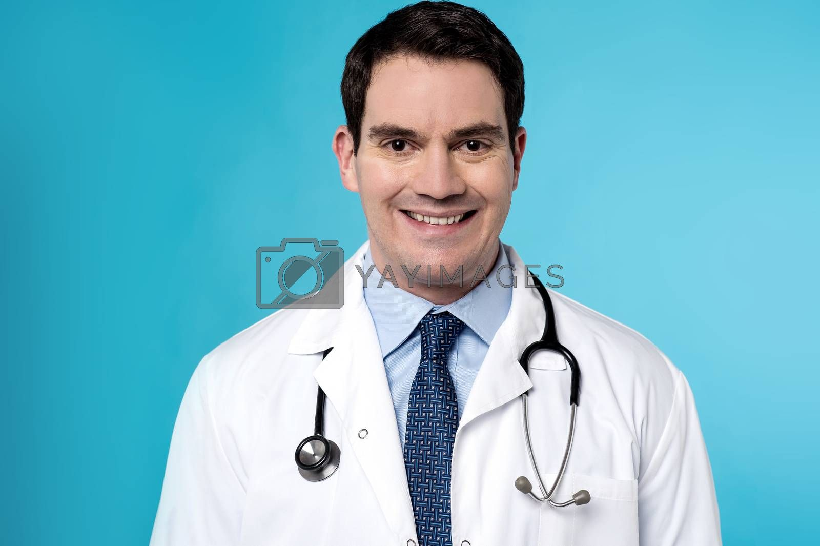 Male physician with stethoscope around his neck