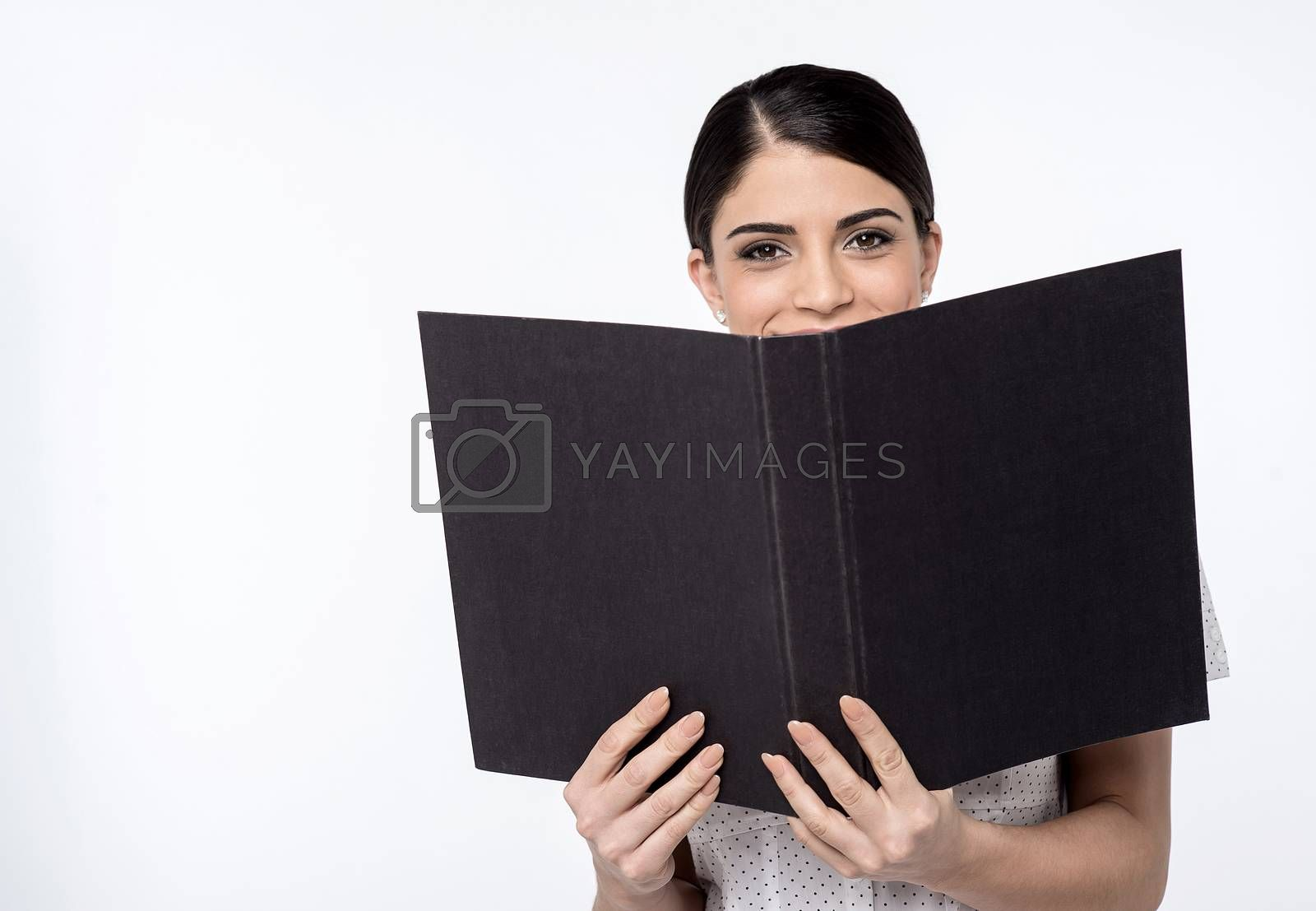 Image of a young female executive with open folder