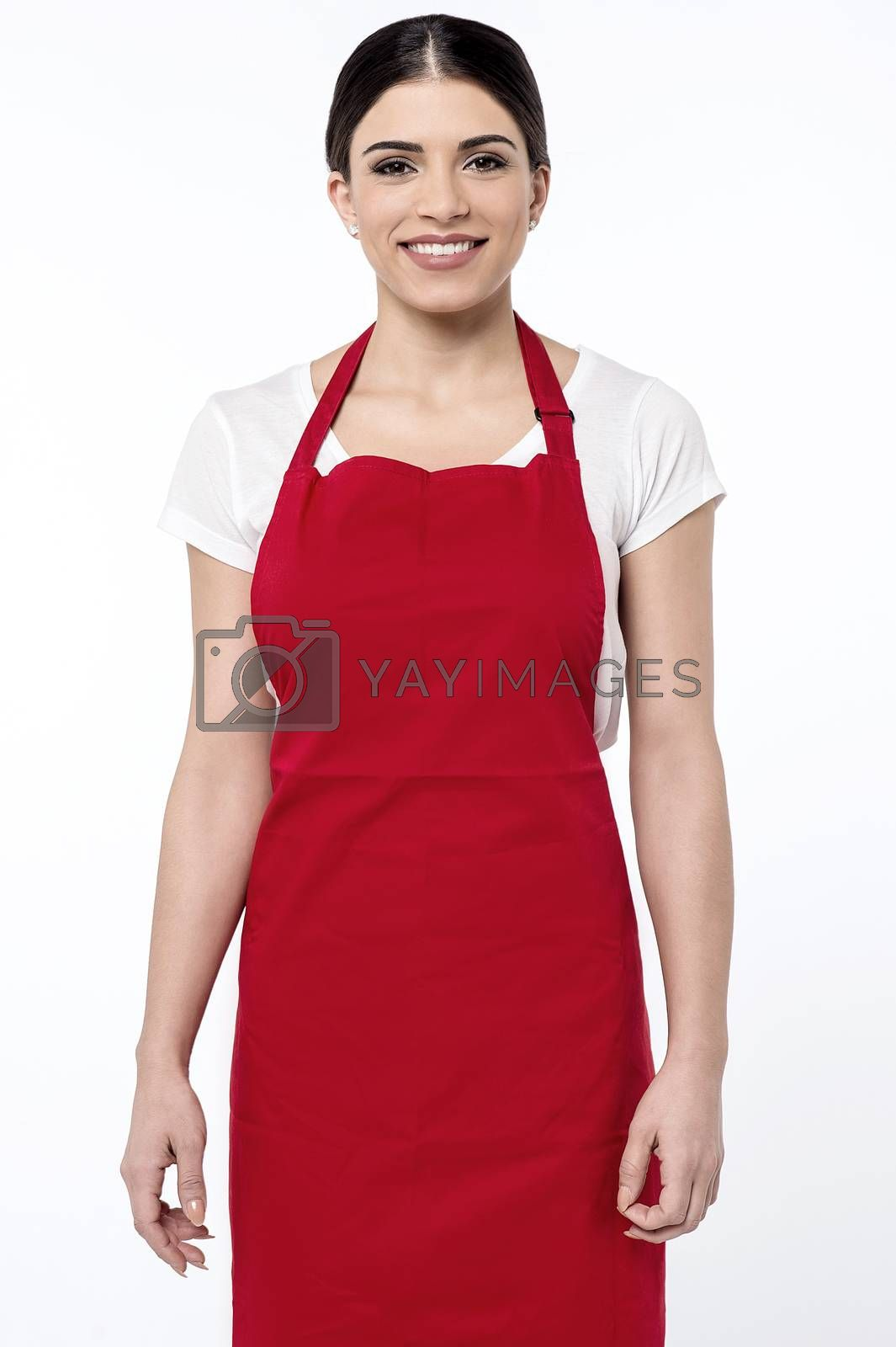 Image of a young female chef posing over white
