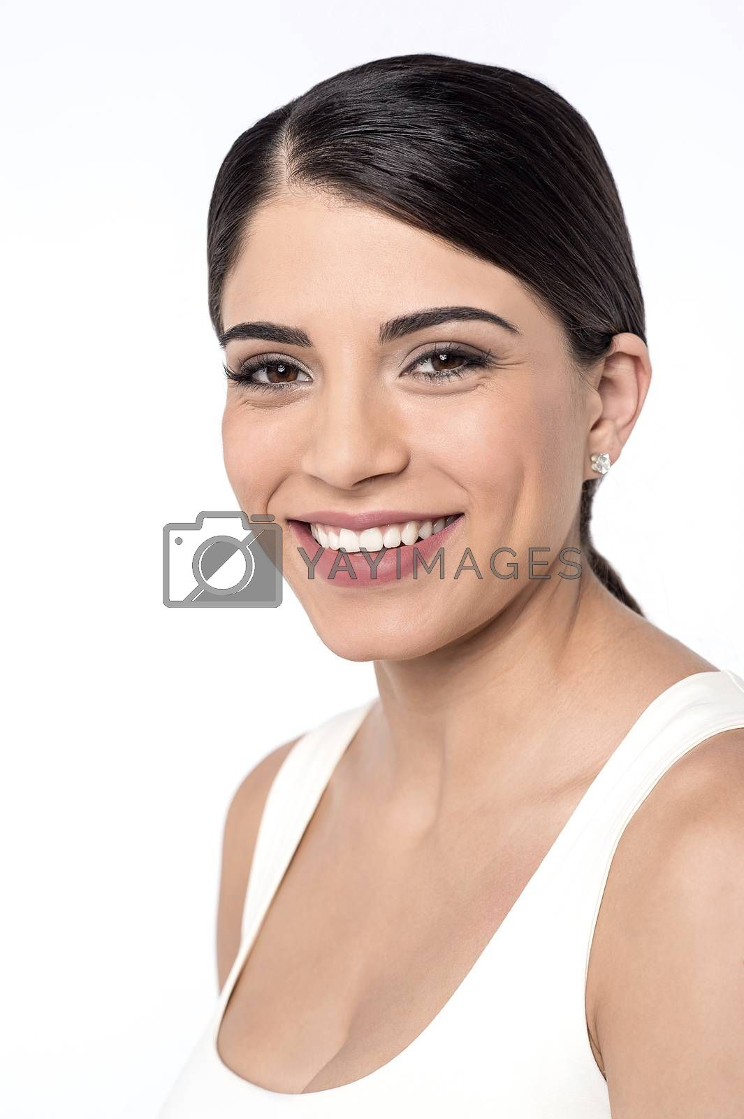 Fit woman posing to camera over white