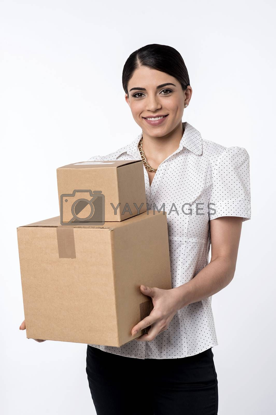 Woman holding stack of carton boxes