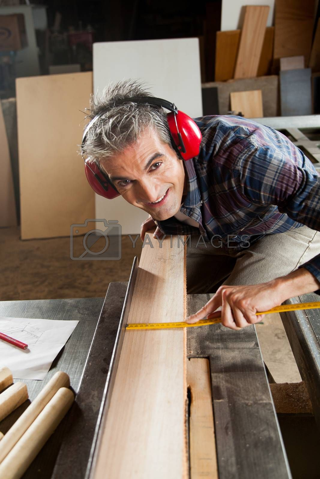 Happy man in his workshop