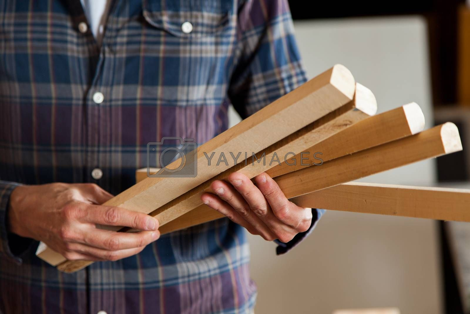 Man holding a pieces of wood