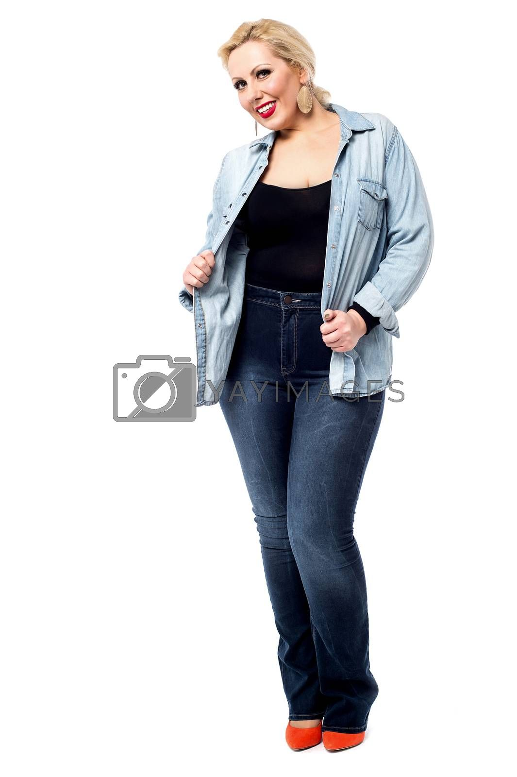 Full length image of trendy middle aged woman