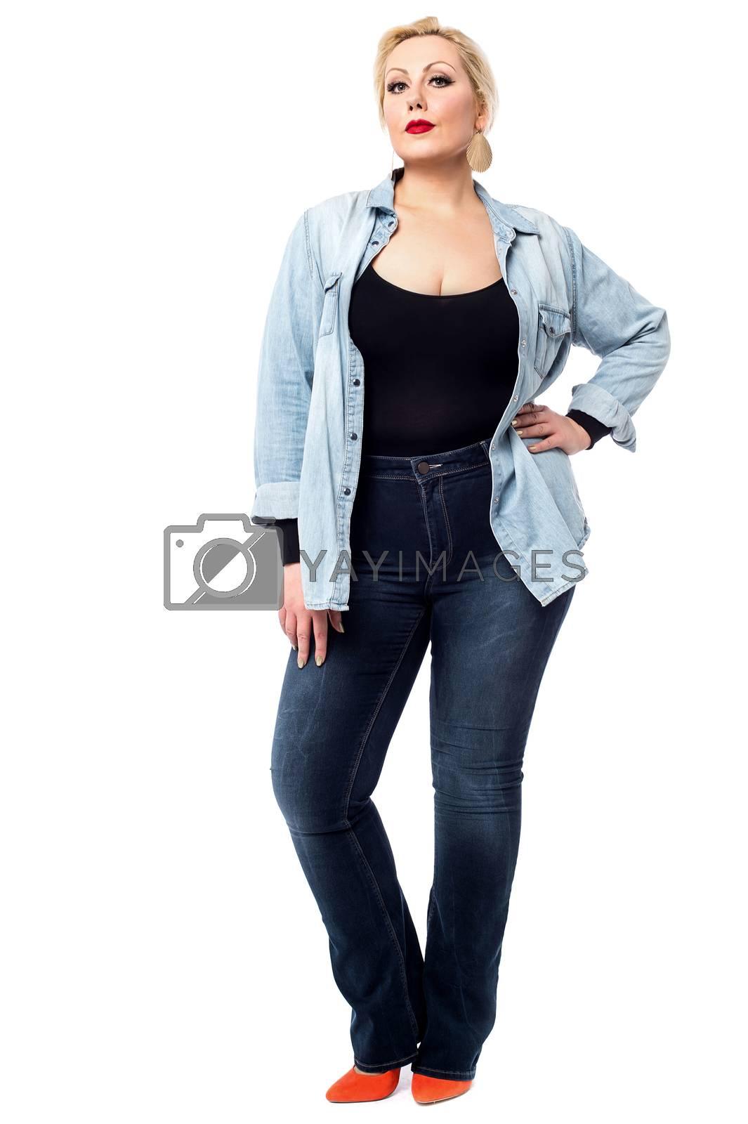 Woman posing to camera casually, full length.