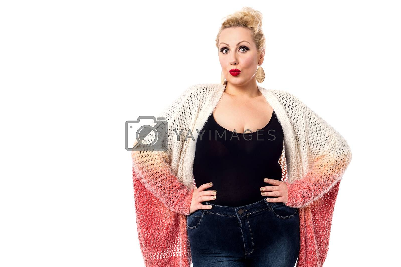 Stylish woman posing with knitted apparel over white