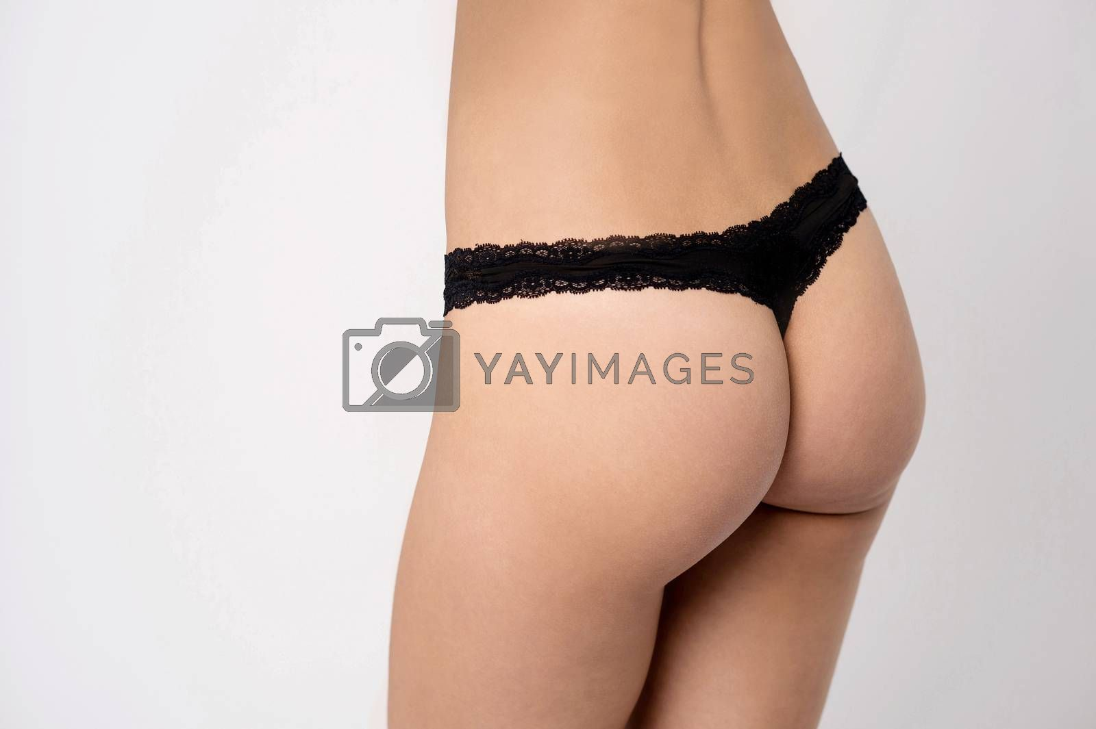 Young woman with nice buttocks