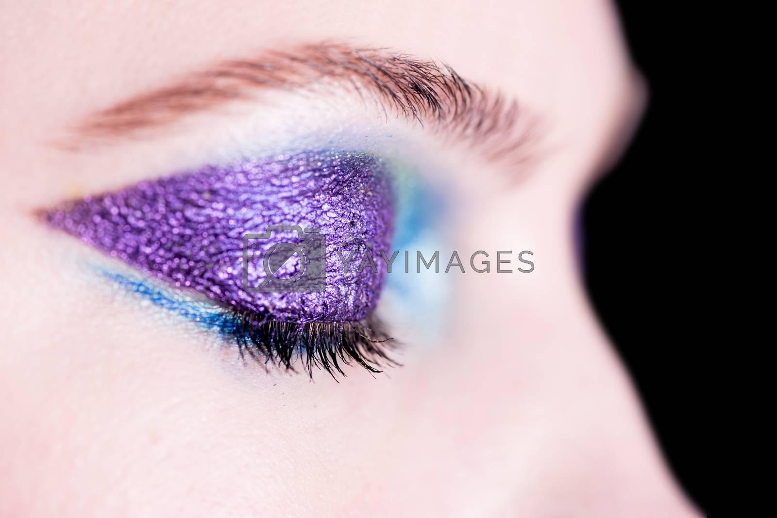 Image of a woman eye with purple eye-shadow
