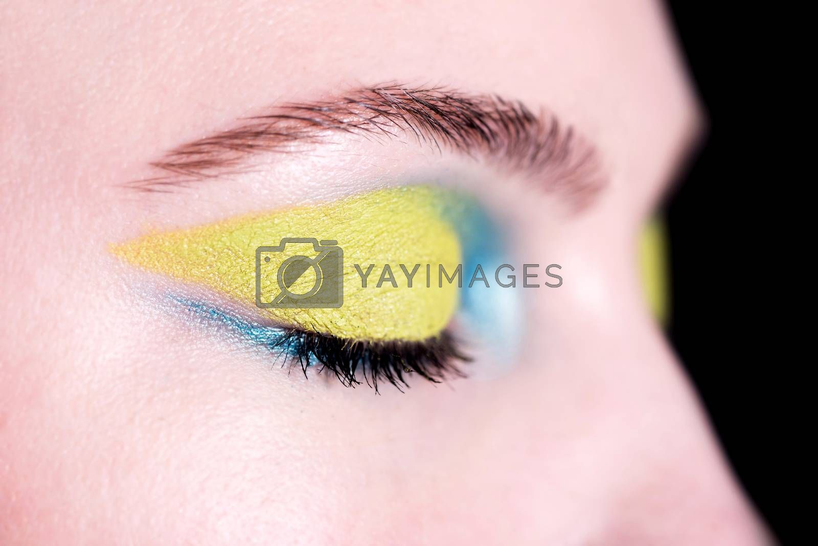 Closeup face of beautiful woman with bright fashion makeup