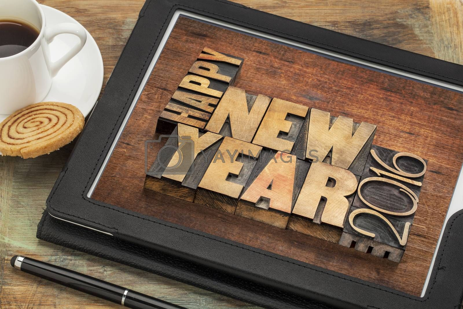 Happy New Year 2016 greetings  - text in vintage letterpress wood type blocks on a digital tablet with a cup of coffee