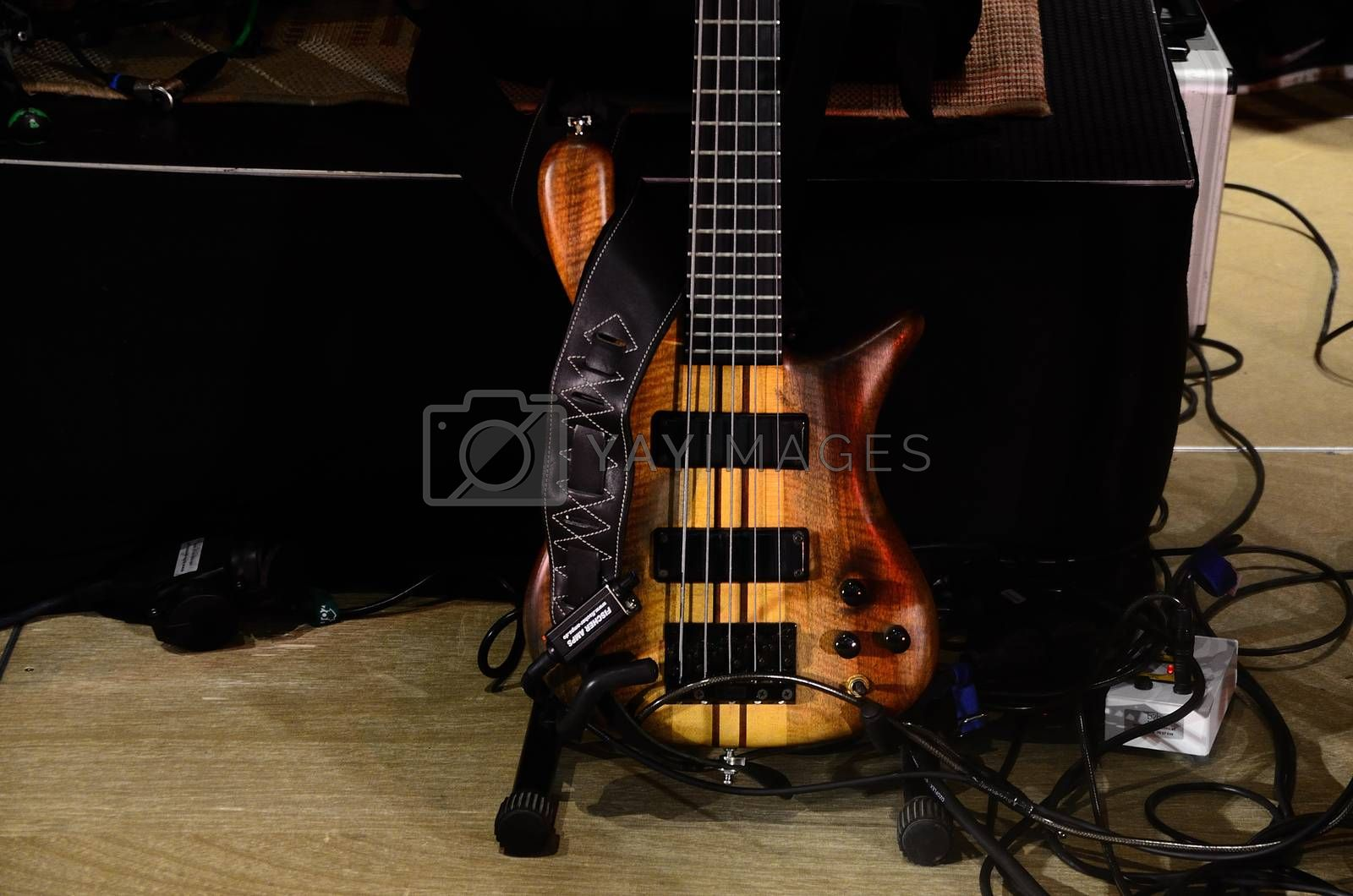 bass guitar natural wood on a stage
