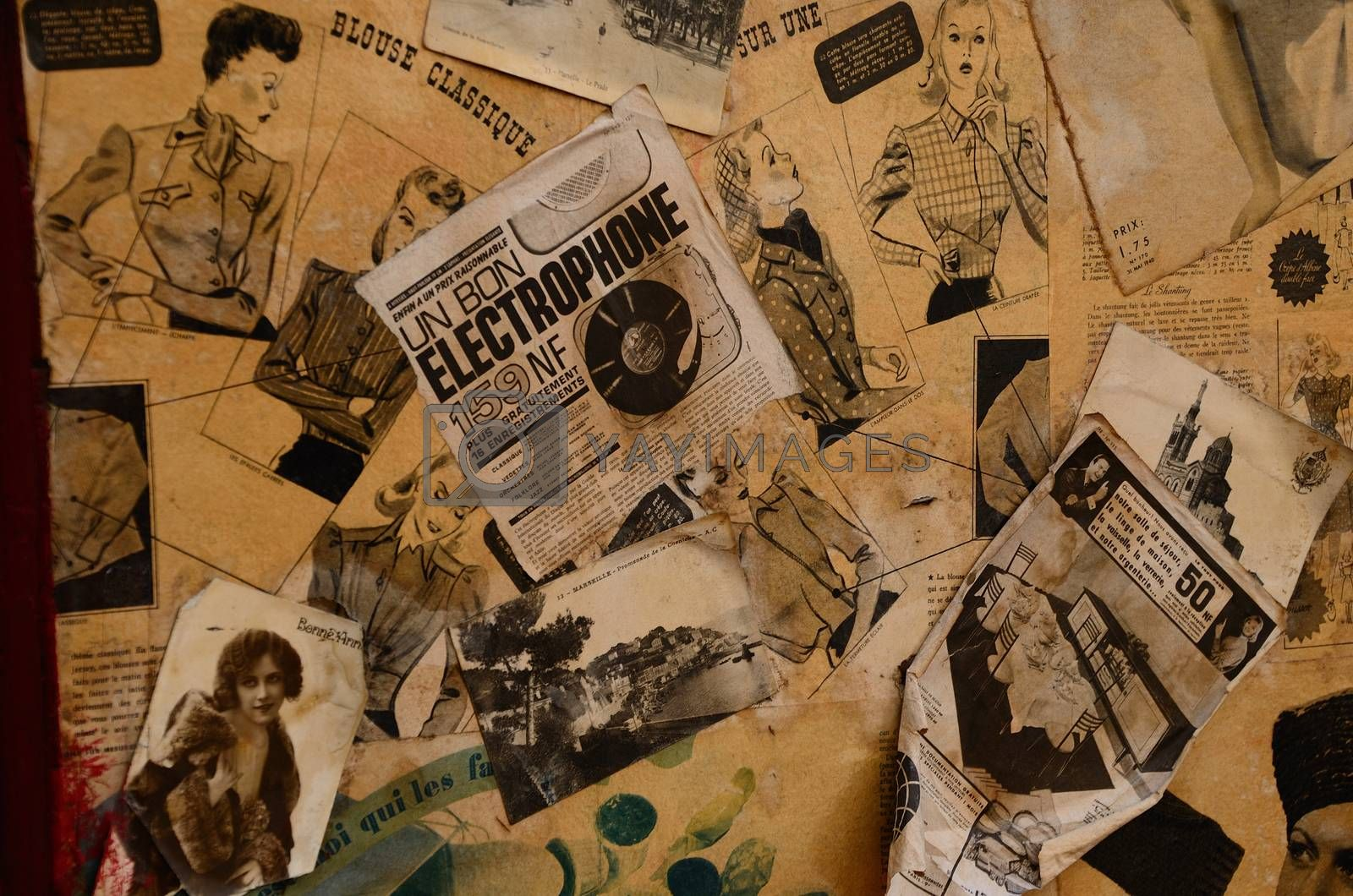 collection of old magazines and cards on a wall