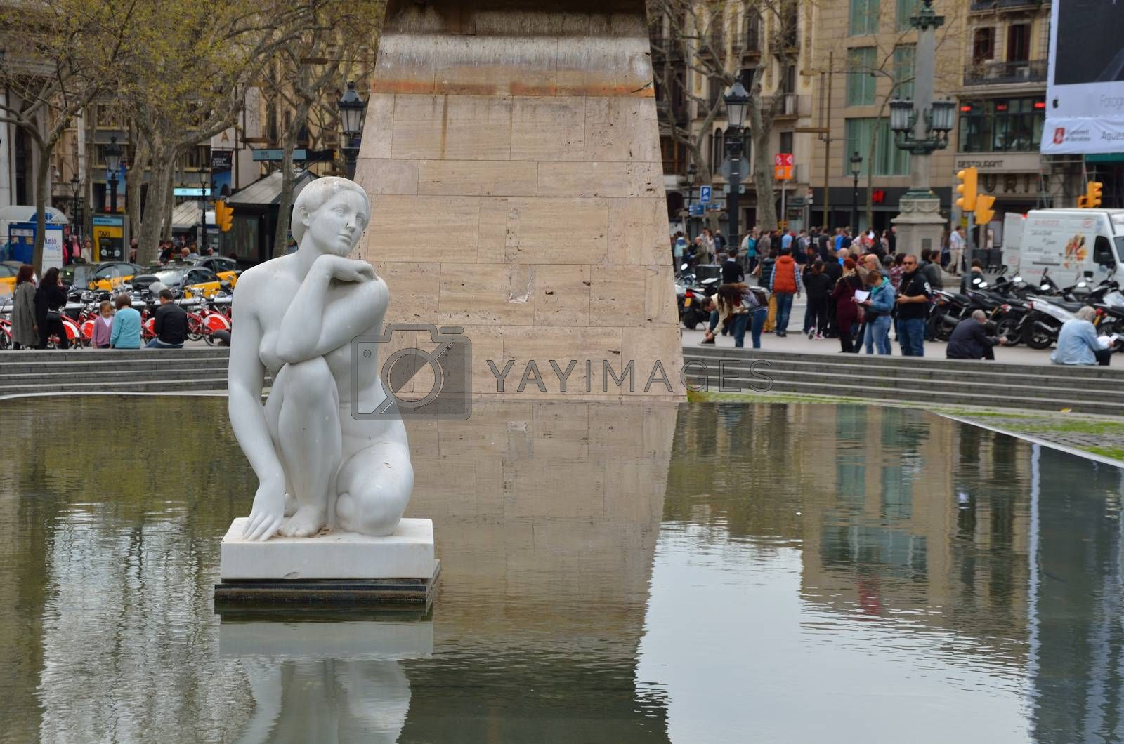 beautiful fountain with female figure in Barcelona