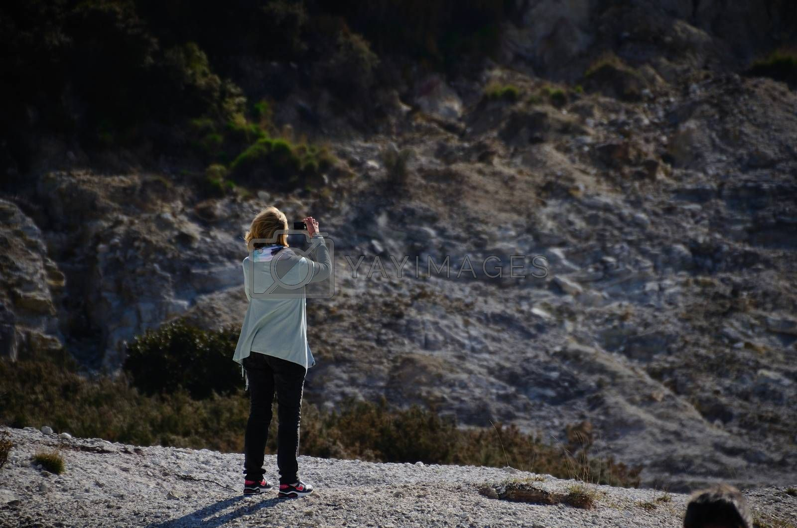 woman photographing in a crater in neapel
