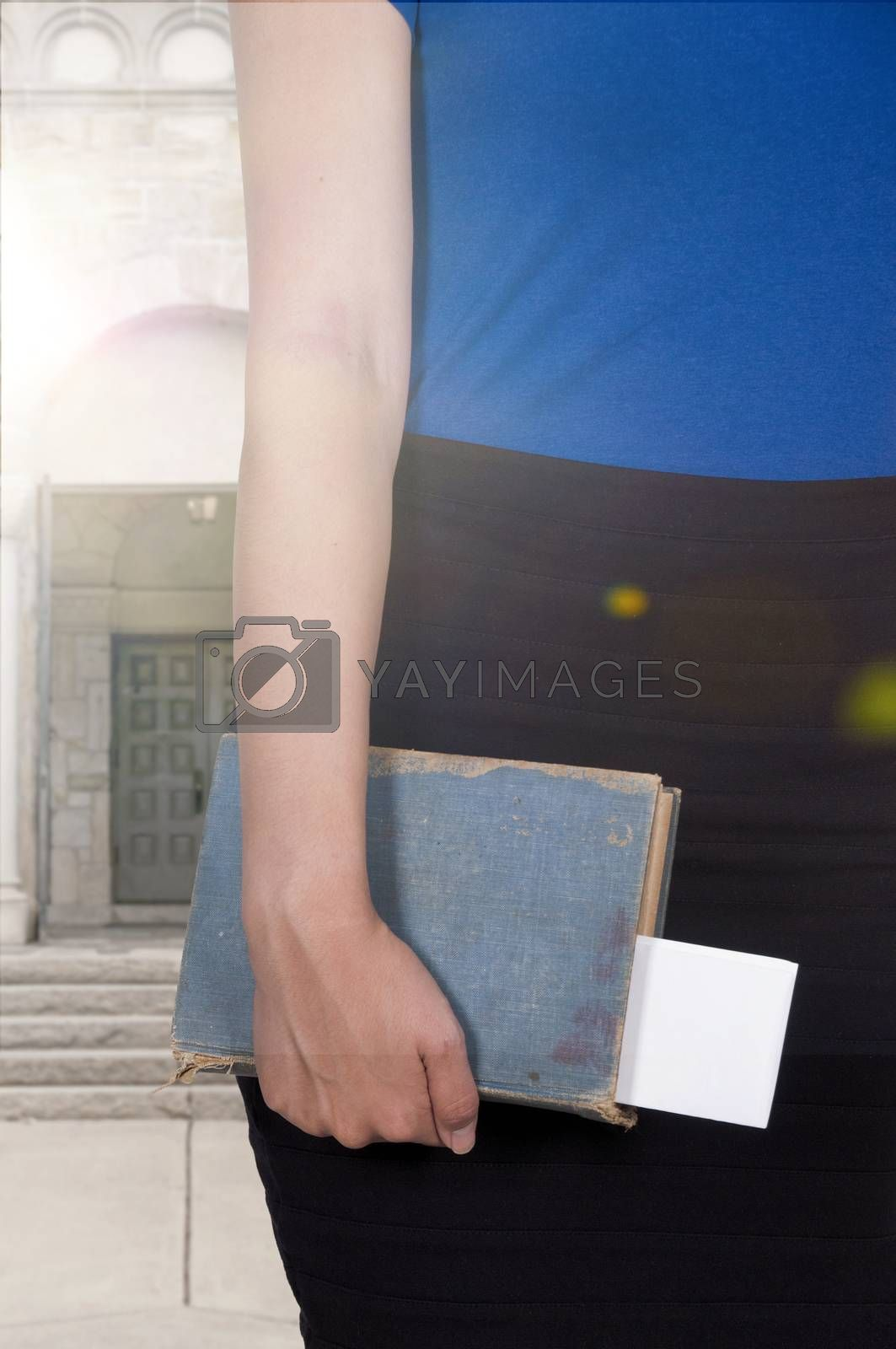 Beautiful woman holding a library book
