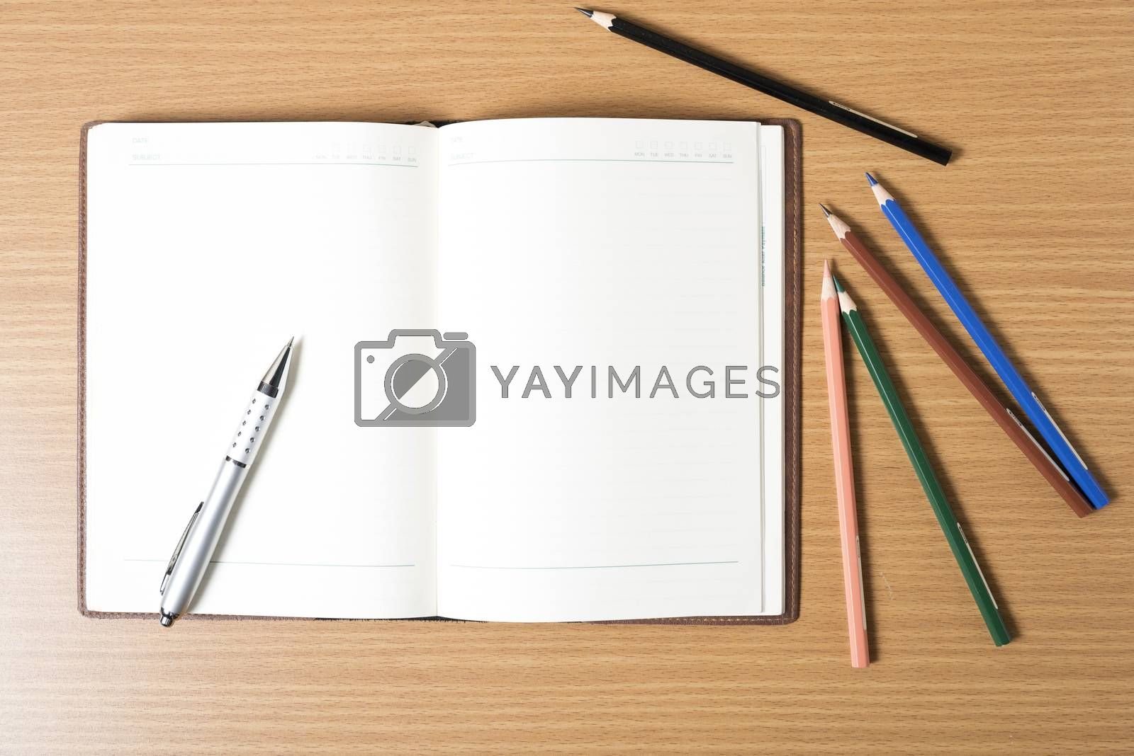 Royalty free image of pen on open notebook by ammza12