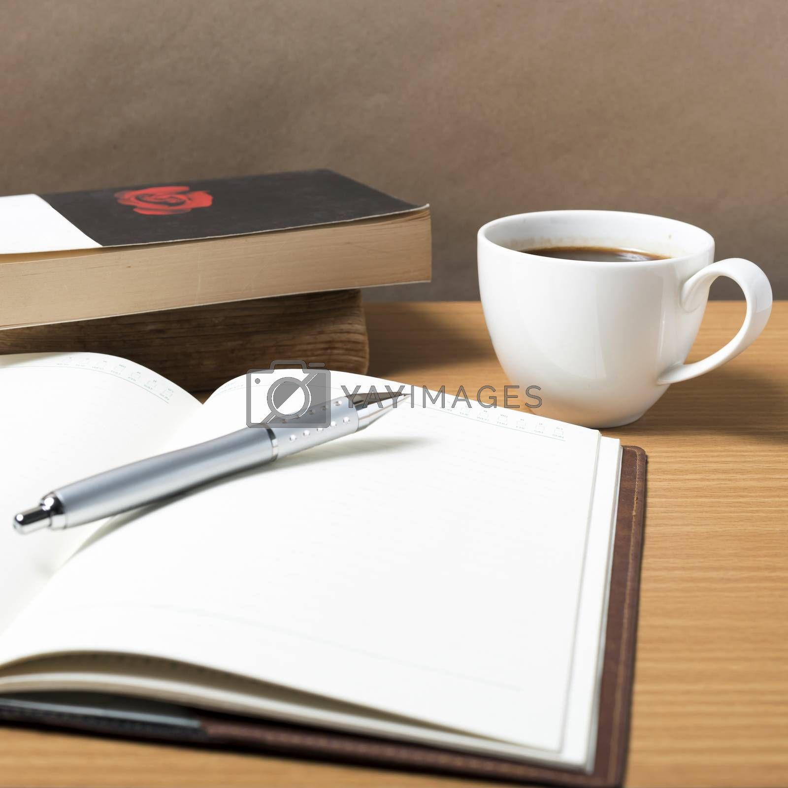 Royalty free image of open book with coffee by ammza12