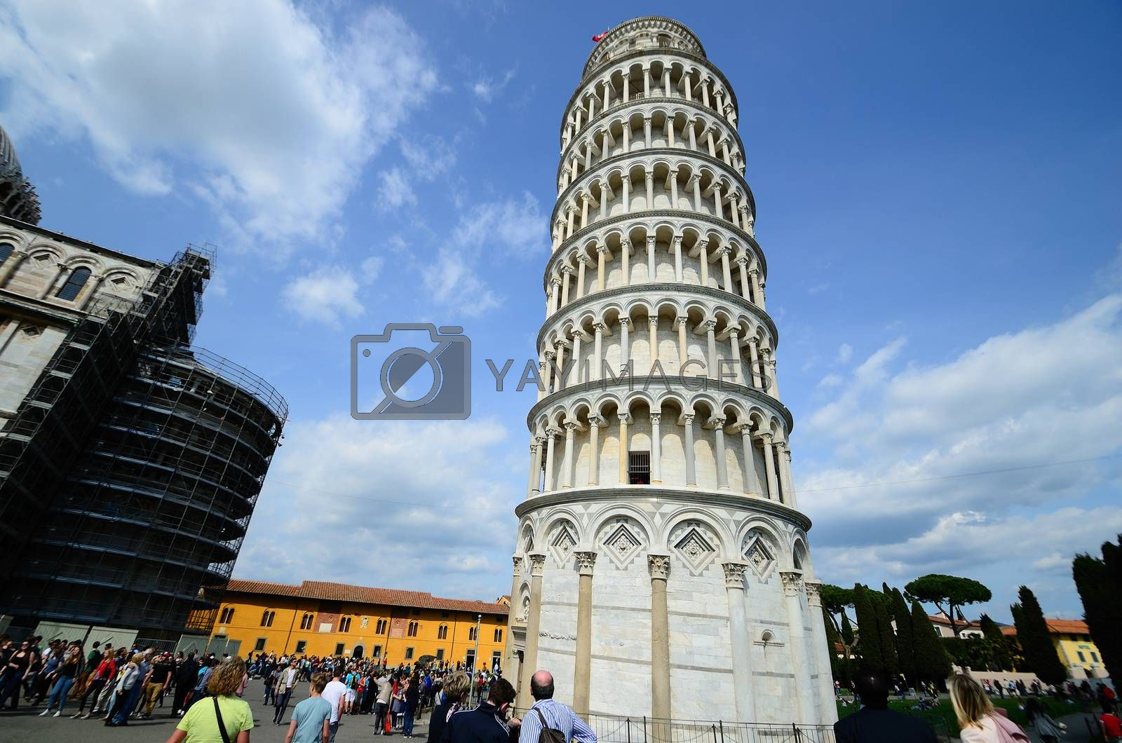 Leaning Tower of Pisa with many tourists and blue sky