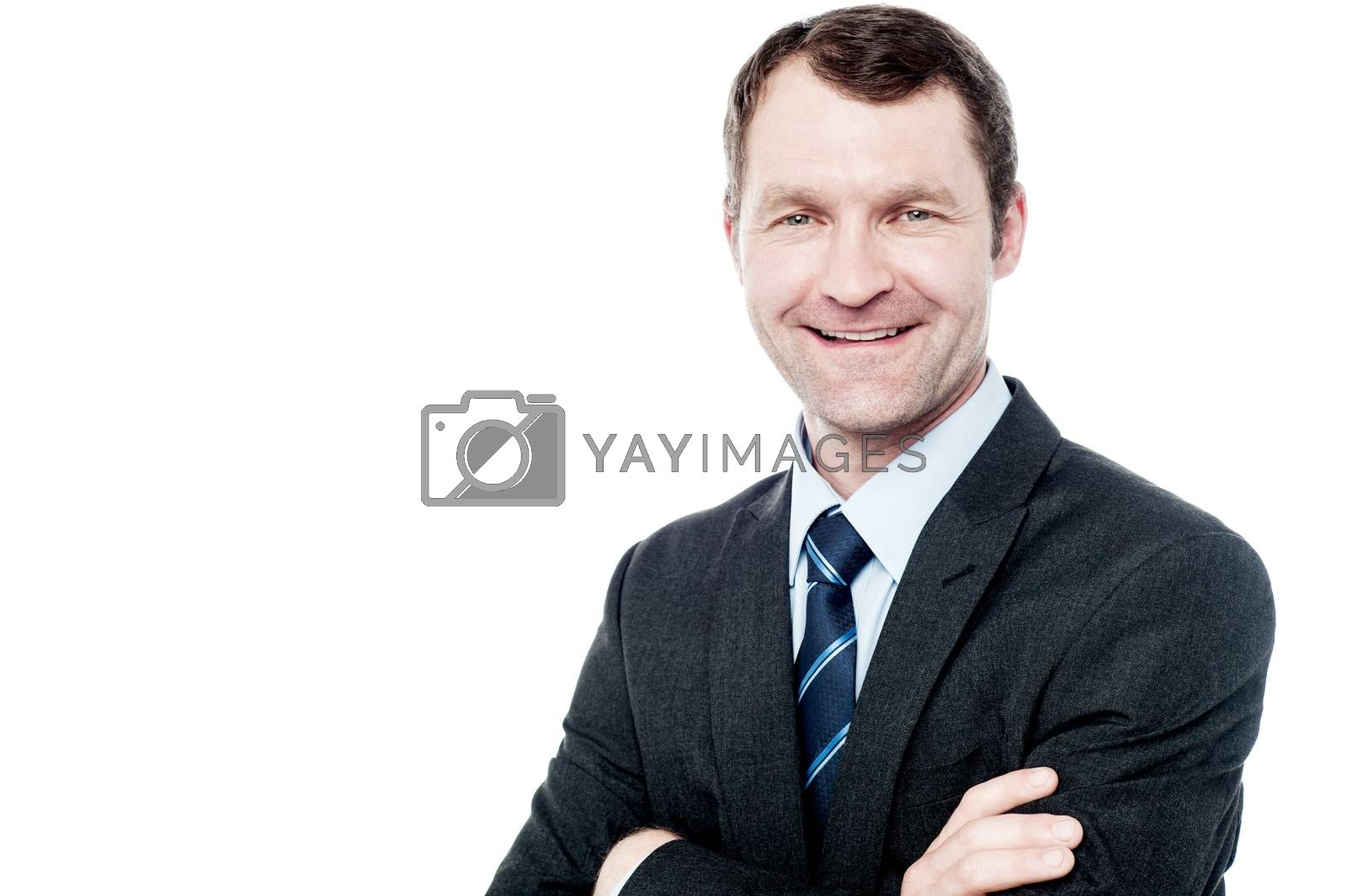 Successful businessman posing with folded arms