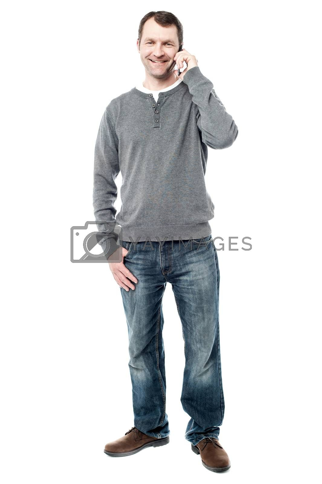 Full length of handsome male talking on cell phone