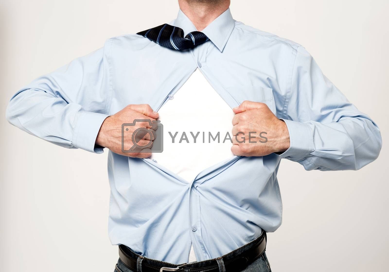 Superhero executive tearing his shirt by stockyimages