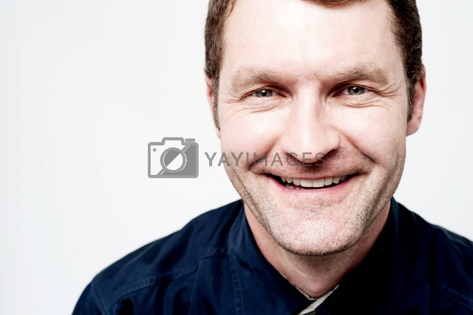 Close up of smiling handsome middle aged man
