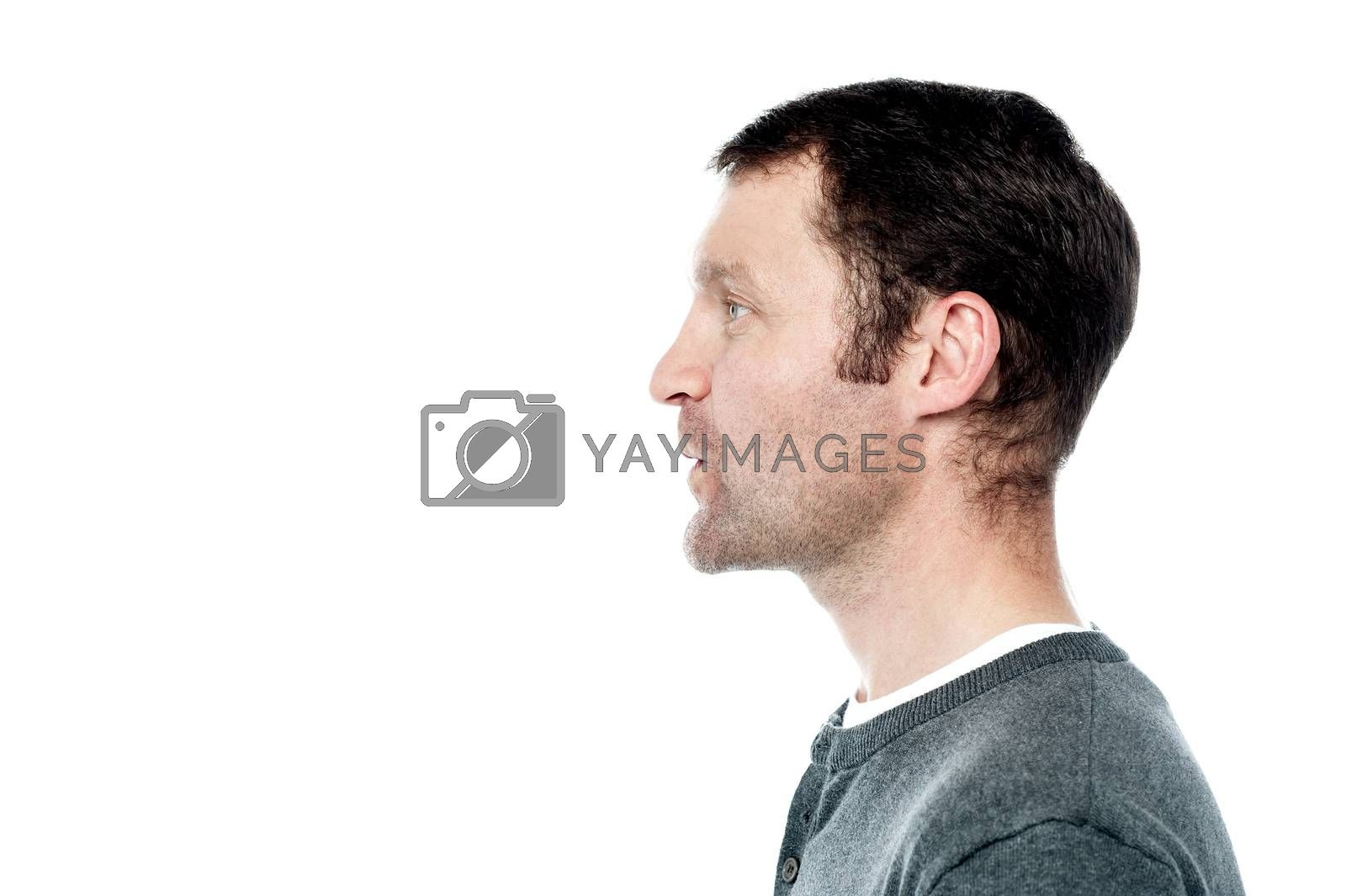 Side pose of middle aged man looking forward