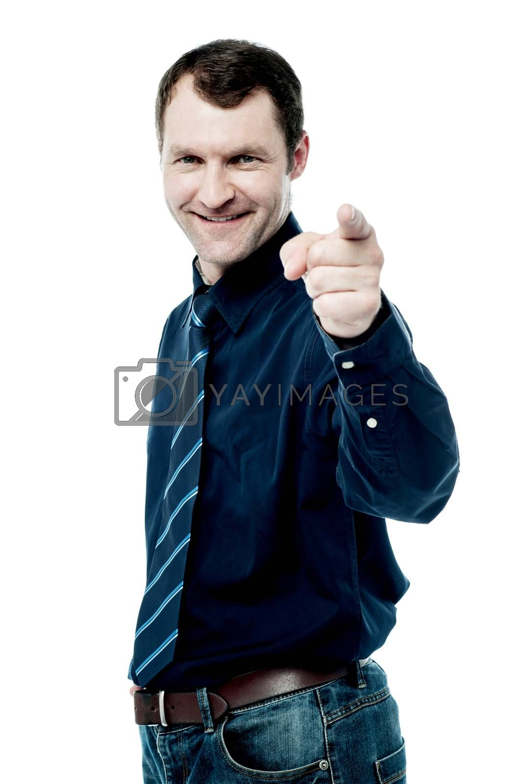 Corporate male pointing his finger towards camera
