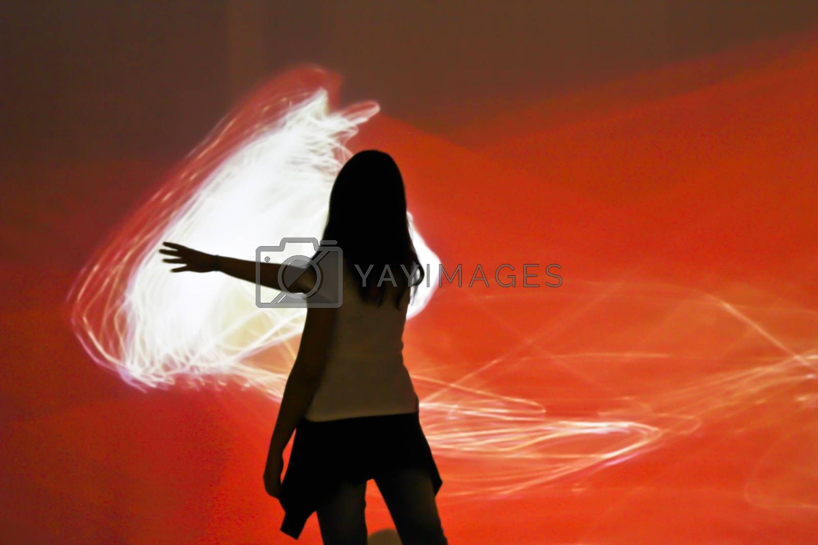 Sao Paulo, Brazil July 5, 2015: Unidentified girl interacting with an electronic artistic work in International fair for electronic language FILE in Sao Paulo Brazil.