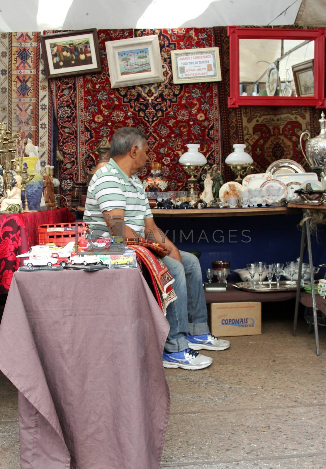 Sao Paulo, Brazil, July 18 2015: Unidentified elderly man in the traditional antique objects market that has been held all Saturdays in Benedito Calixto square in Sao Paulo Brazil.