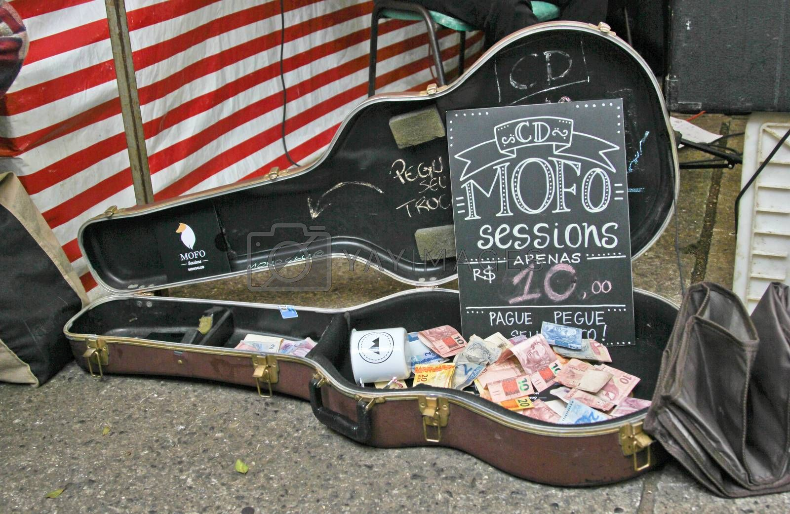 Sao Paulo, Brazil, July 18 2015: Detail of music contribution for a band in the traditional antique objects market that has been held all Saturdays in Benedito Calixto square in Sao Paulo Brazil.
