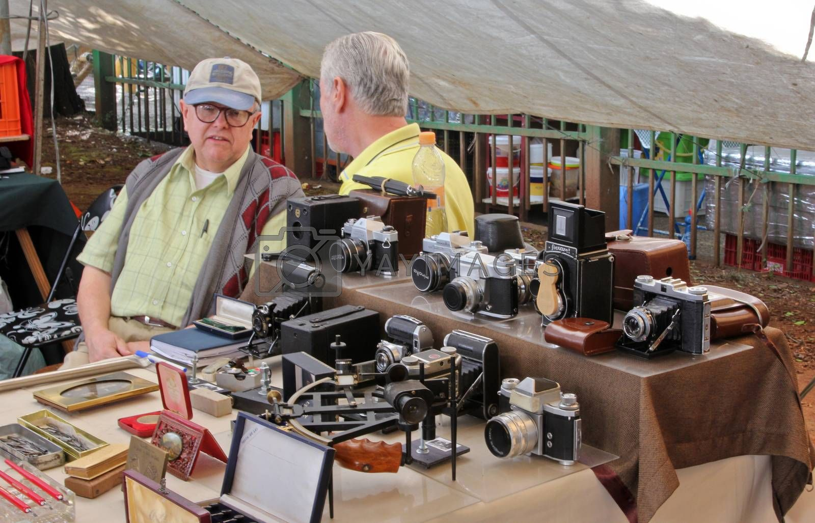 Sao Paulo, Brazil, July 18 2015: Unidentified elderly men in the traditional antique objects market that has been held all Saturdays in Benedito Calixto square in Sao Paulo Brazil.