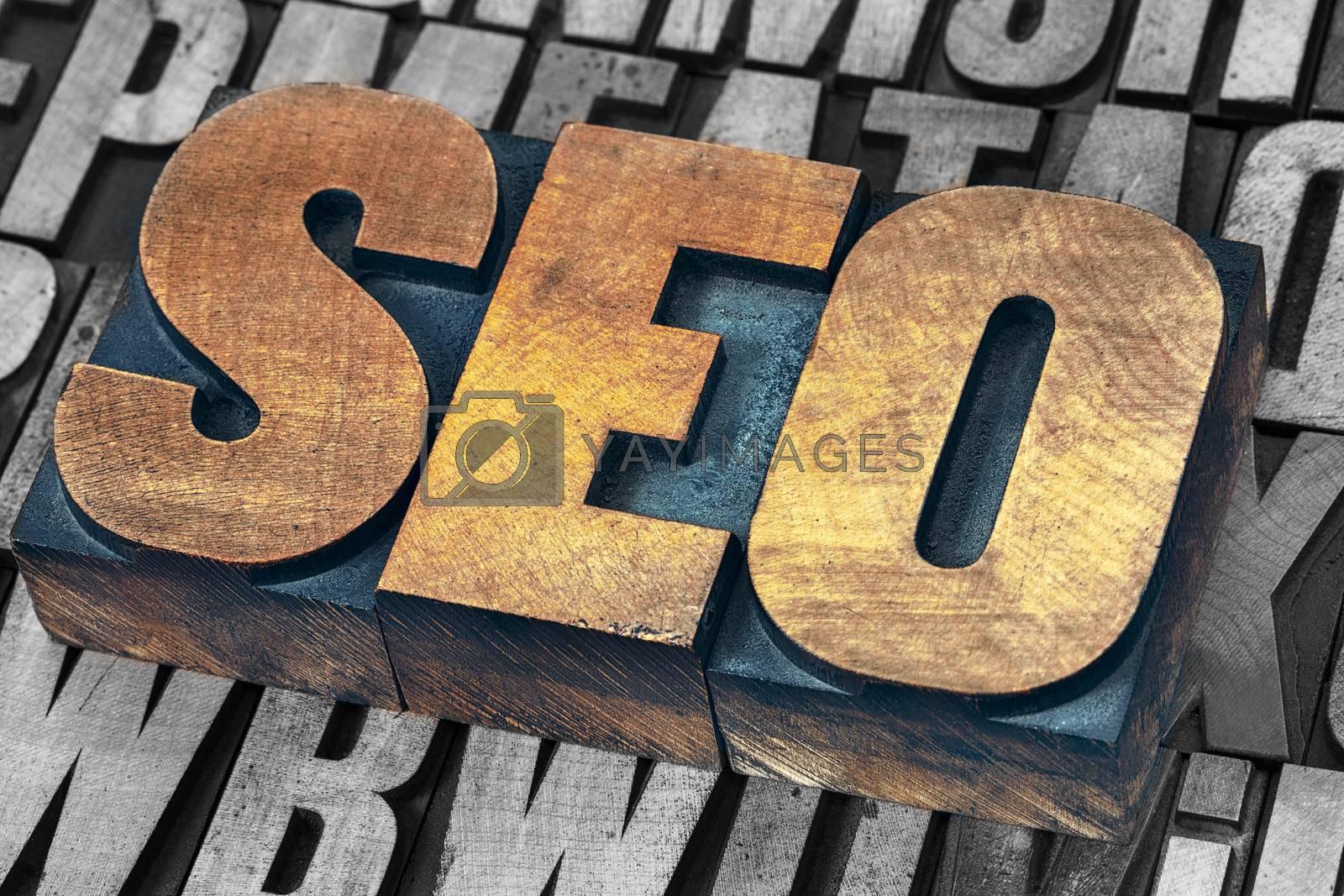 SEO (search engine optimization) acronym - text in vintage grunge letterpress wood type