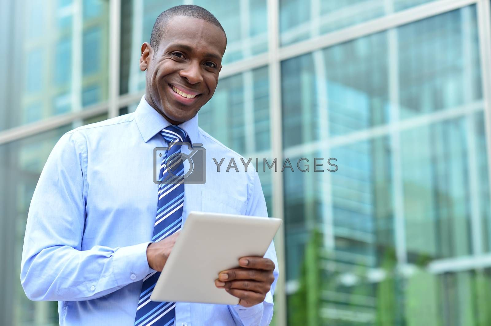 Middle aged businessman using tablet at outdoors