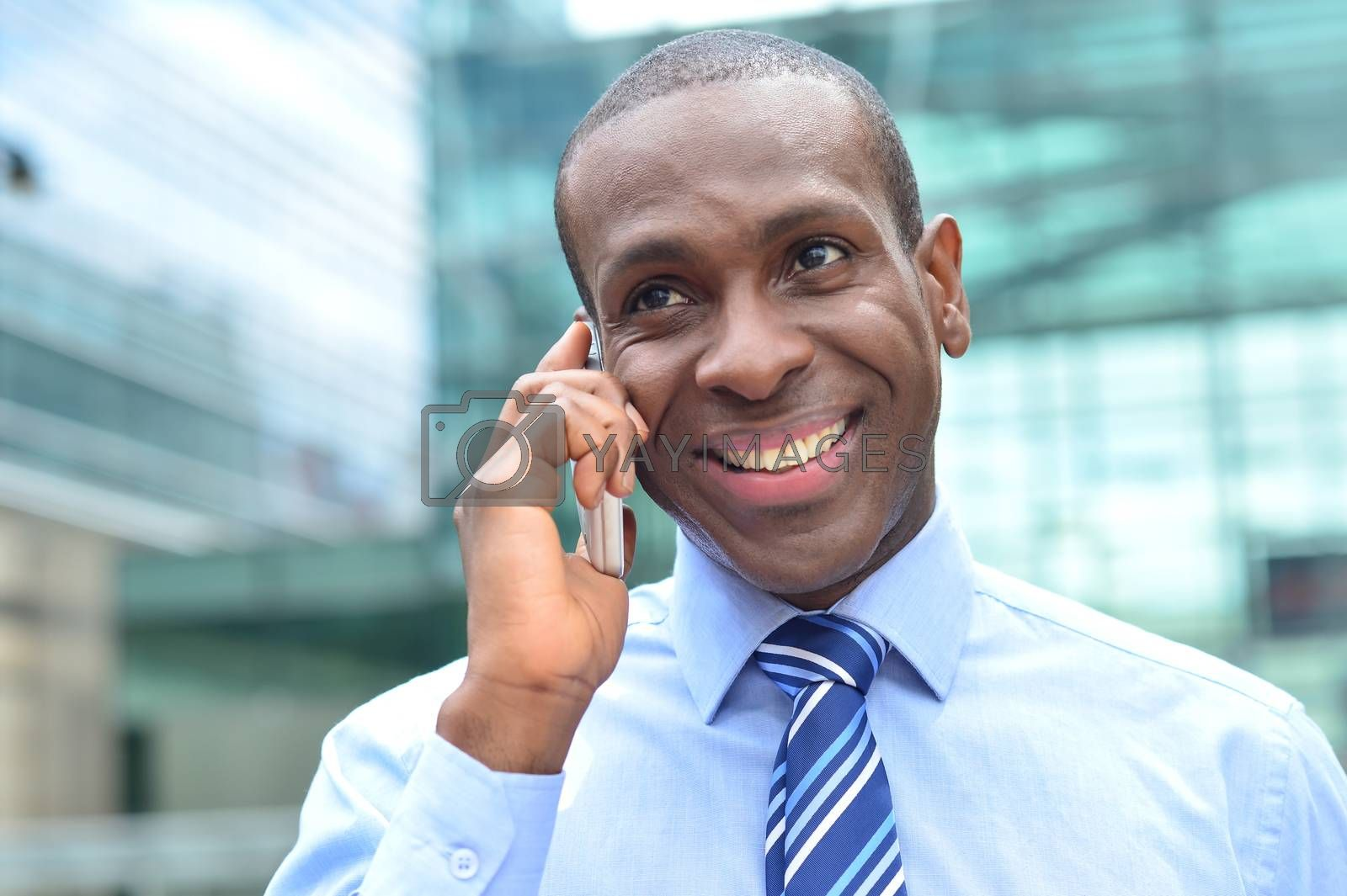 Happy corporate male speaking on his cell phone