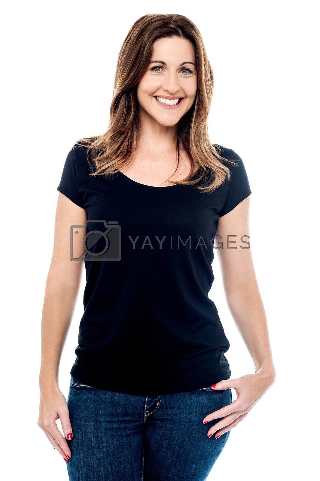 Relaxed woman posing in casual wear over white