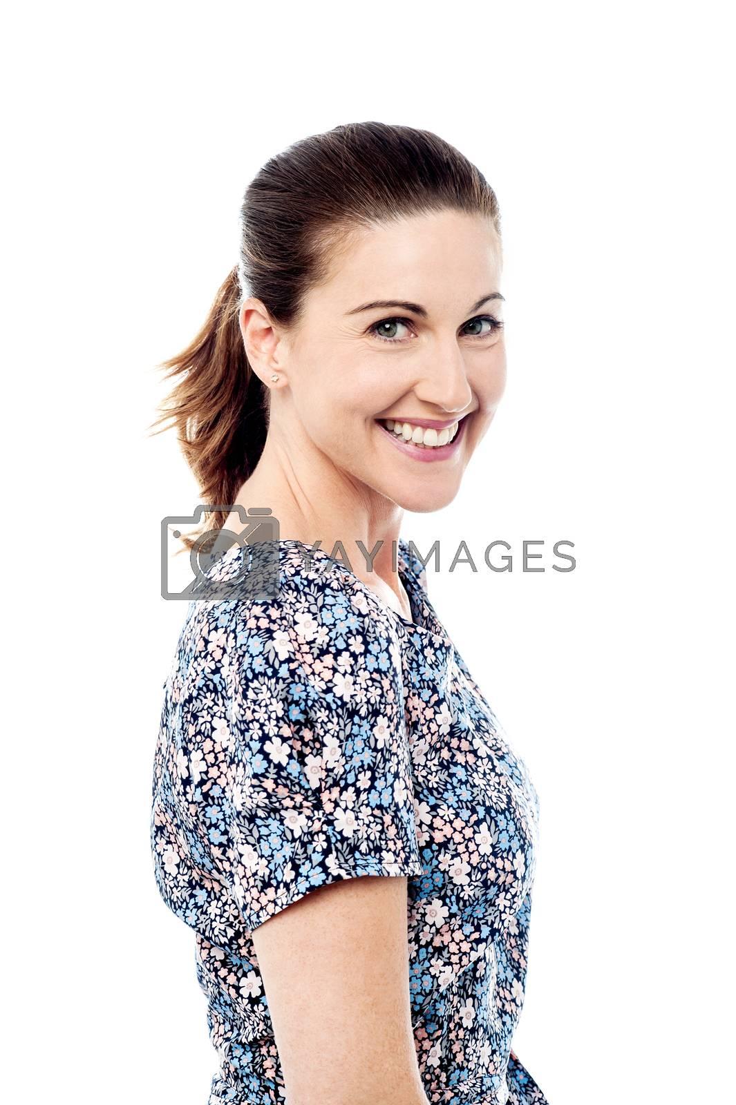 Side pose smiling woman looking at camera.