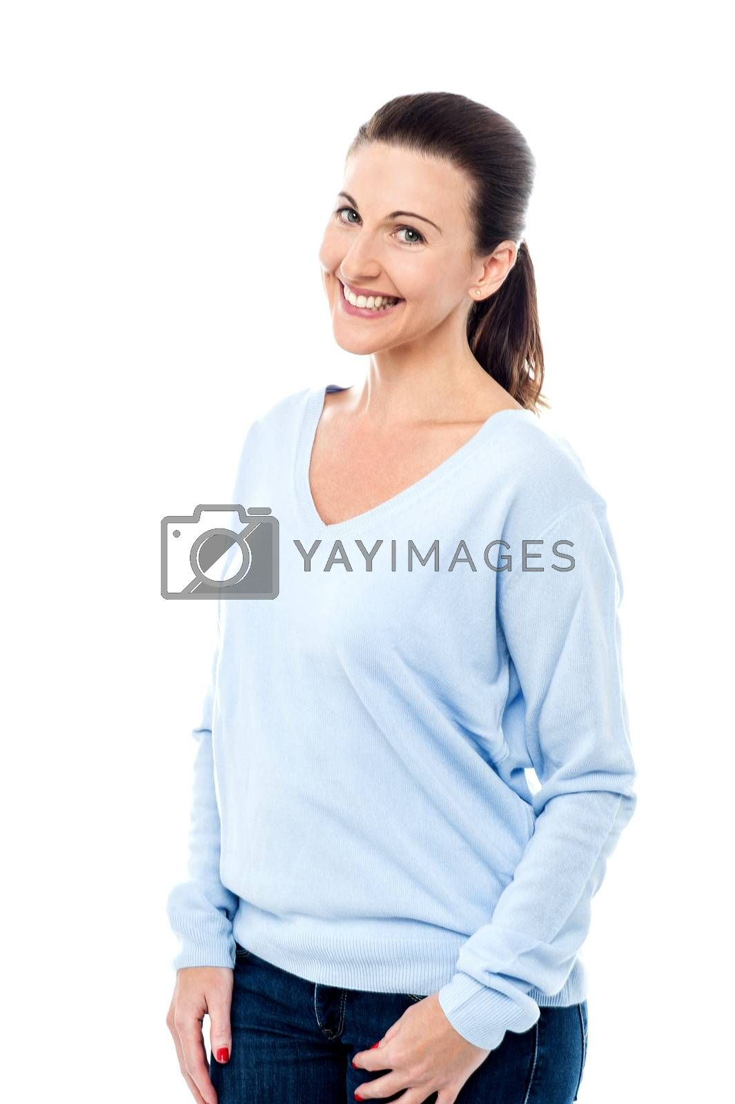Fashionable woman posing with hands in pockets