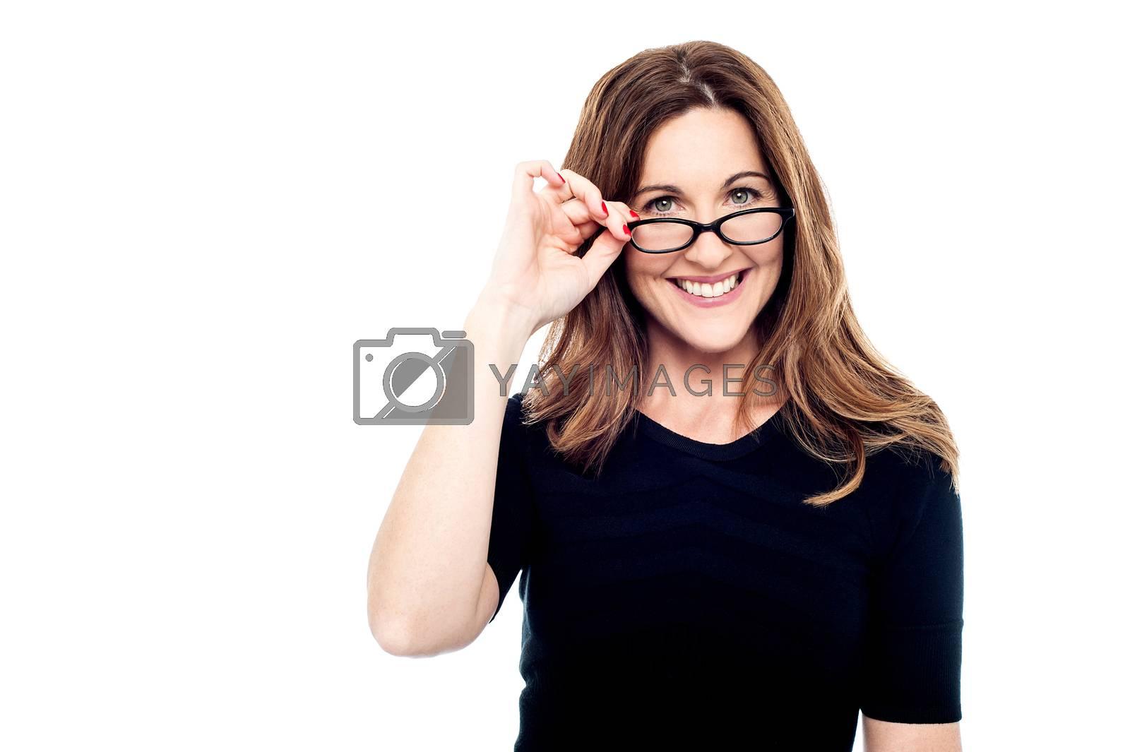 Smiling woman adjusting her eyeglasses